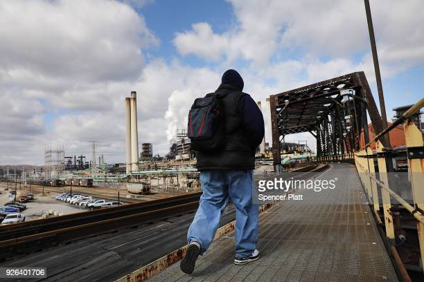 A man walks into the United States Steel Corporation plant in the town of Clairton on March 2 2018 in Clairton Pennsylvania In a controversial move...