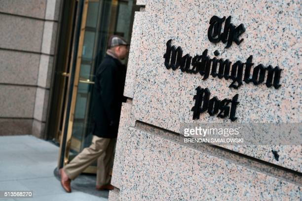 A man walks into the Washington Post's new building March 3 2016 in Washington DC A view of the Washington Post's new building March 3 2016 in...
