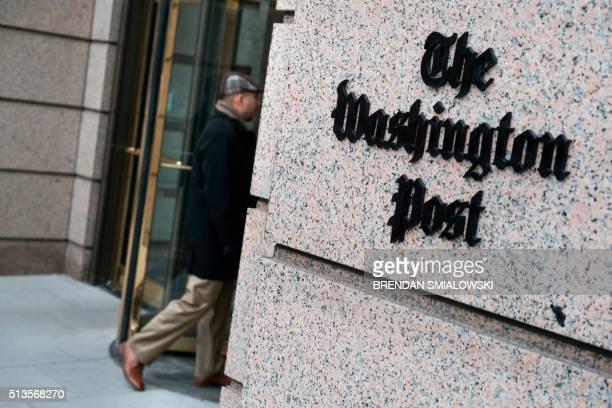 Man walks into the Washington Post's new building March 3, 2016 in Washington, DC. - A view of the Washington Post's new building March 3, 2016 in...