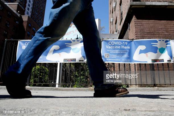 Man walks near a Covid-19 Vaccination Center on April 13, 2021 in New York City. U.S. Federal health officials called for a pause in the use of the...