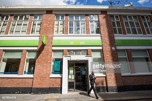 A man walks near a Job Centre in Westminster on May 3 2016 in London England The Resolution Foundation chaired by former Conservative Minister David...