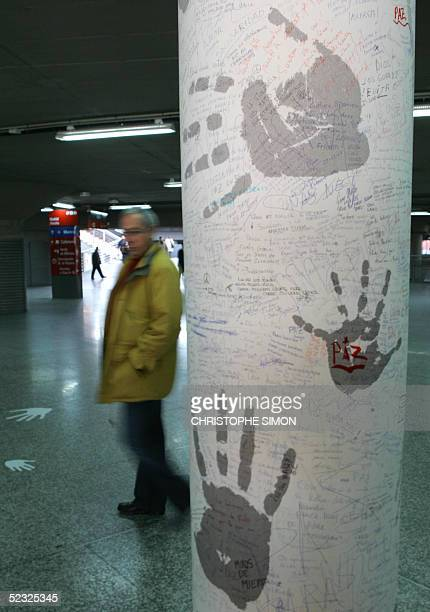 A man walks near by the Wall of Words at the Atocha railway station in Madrid 09 March 2005 Relatives of many of those killed in the March 11 2004...
