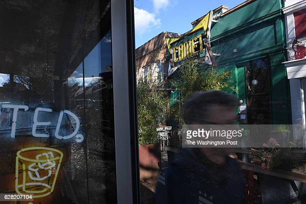 A man walks near Comet Ping Pong on Monday Decmmber 05 2016 in Washington DC A man identified as Edgar Maddison Welch was arrested Sunday after...