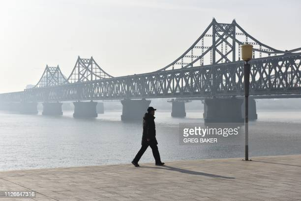 Man walks near the Friendship Bridge which spans the Yalu River between China and North Korea, in the Chinese border city of Dandong, in China's...