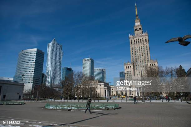 A man walks near the Palace of Culture and Science in Warsaw