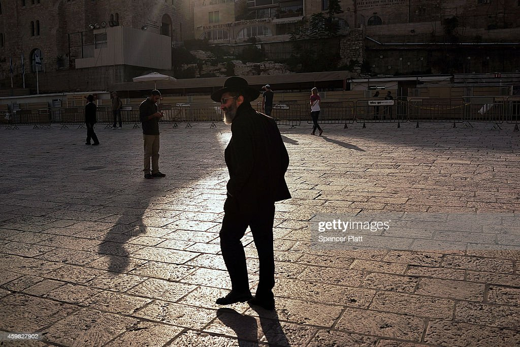 A man walks near the Western Wall in the Old City on December 02, 2014 in Jerusalem, Israel. As violence continues in Israel, an Israeli was stabbed and lightly injured Monday morning in the West Bank south of Jerusalem. Nine Israelis have been killed in a series of stabbings, shootings and hit-and-run attacks in Jerusalem over the past month, unsettling the ancient city of Jerusalem where Jews, Christians and Muslims have lived side by side for thousands of years. The tension and violence on the streets of the city is threatening to further isolate communities and to encourage extremist politicians exploit the situation.
