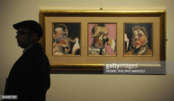 A man walks next to Irish bornEnglish artist Francis Bacon's painting Three studies for portraits including selfportrait exhibited at Prado Museum in...