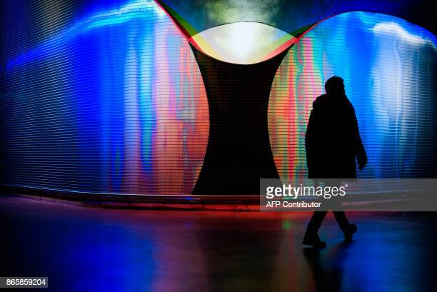 A man walks next to 'Moaritisk Absorbent' by artist Mikael Paulin located at the new city line station of Stockholm City on October 24 2017...