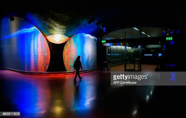 A man walks next to 'Moaritisk Absorbent' by artist Mikael Paulin located at the new city line station of Stockholm City on October 24 2017 The two...