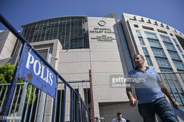 Man walks next to police barriers next to Istanbul's courthouse on September 18 during the trial of a US consulate staffer accused of spying and...