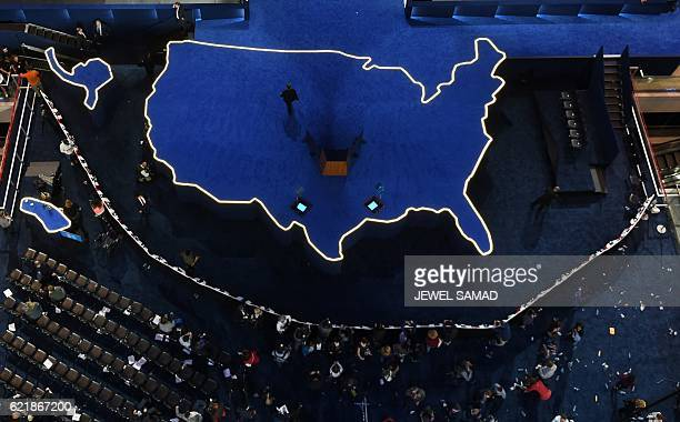 A man walks off an empty stage after Democratic presidential nominee Hillary Clinton did not arrive to speak during election night at the Jacob K...