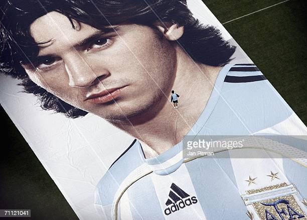 A man walks on a 60 by 15 metre big poster of Lionel Messi of Argentina at World of Sports Stadium on June 4 2006 in Herzogenaurach Germany