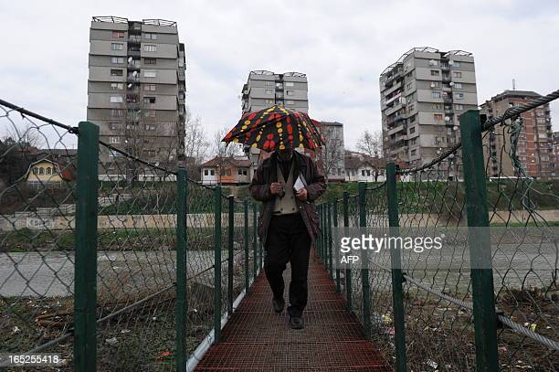 A man walks on a bridge in the divided town of Mitrovica on April 2 2013The latest round of EUsponsored talks aimed at normalizing relations between...