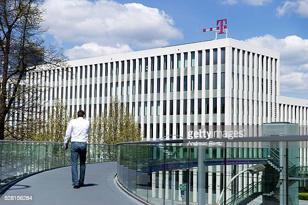 A man walks on a bridge which connects the buildings of the Deutsche Telekom headquarters on May 04 2016 in Bonn Germany