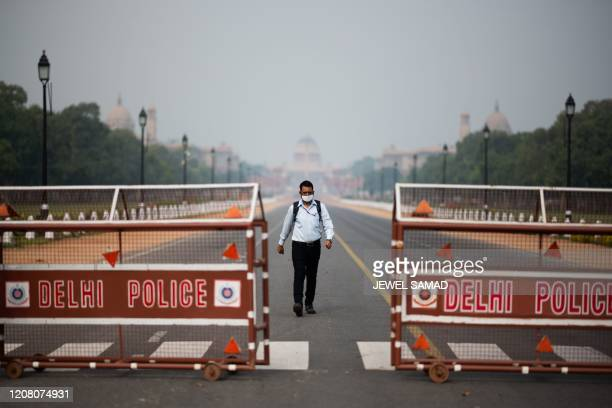 A man walks on a deserted Rajpath leading to the Presidential Palace during a governmentimposed lockdown as a preventive measure against the COVID19...