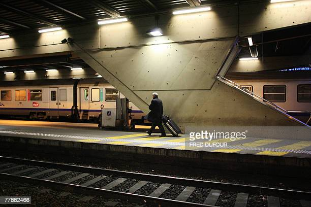 A man walks on a railway platform 13 November 2007 at the Perrache' train station of Lyon France faces several 'hellish' days as railway and metro...