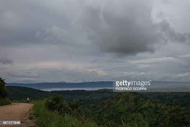A man walks on a road linking the highlands around the South Kivu town of Fizi to the shores of Lake Tanganyika lake on March 24 2015 AFP PHOTO /...