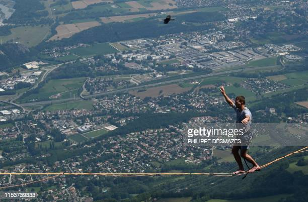 Man walks on a slackline during the 7th edition of the European 'Marmotte Highline Project' festival in Lans-en-Vercors, near Grenoble, eastern...