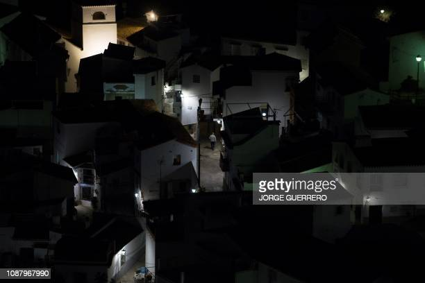 TOPSHOT A man walks on a street in Totalan southern Spain on January 24 2019 Miners were lowered on a cage to rescue twoyearold Julen Rosello who...