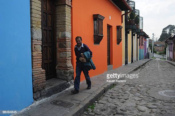 A man walks on a typical street in Candeleria old part of Bogota Bogota formerly called Santa Fe de Bogota is the capital city of Colombia as well as...