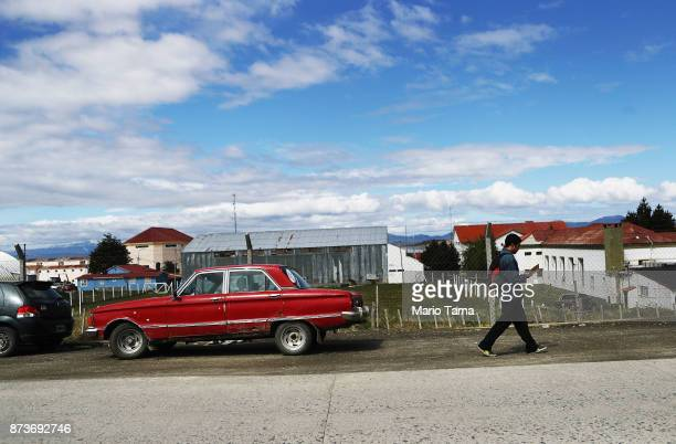 A man walks on a warm day on November 7 2017 in Ushuaia Argentina Ushuaia is situated along the southern edge of Tierra del Fuego in the Patagonia...