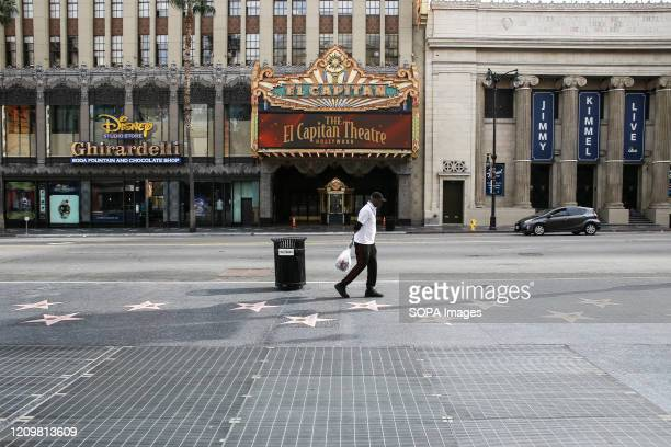 Man walks on an empty Hollywood Boulevard while Californian's are urged to stay at home to prevent the spread of COVID-19. As COVID-19 continues to...