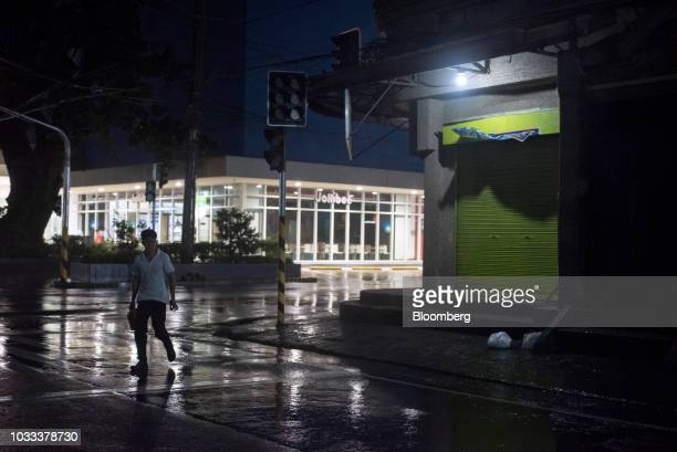 A man walks on an empty street ahead of Typhoon Mangkhut's arrival in Tuguegarao Cagayan province the Philippines on Friday Sept 14 2018 Super...