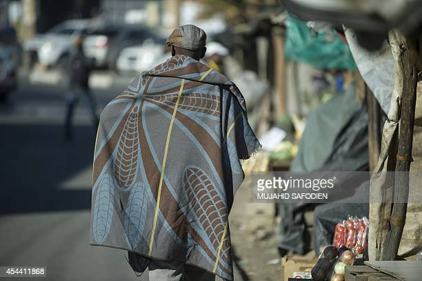 Man walks on August 31, 2014 in a market in Maseru. Lesotho Prime Minister Tom Thabane claimed on August 30 he fled for his life after soldiers...