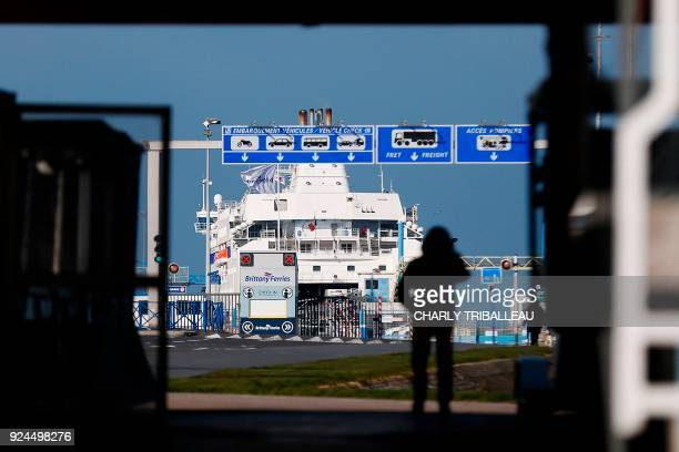 A man walks on February 26 outside the port of Ouistreham near Caen Northwestern France More than a year after the dismantling of the 'jungle'...