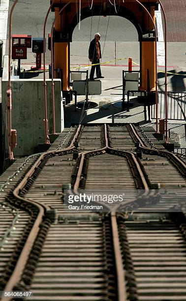 A man walks on Hill St in downtown LA after it was announced on Tuesday 1/23/2007 that Angels Flight is expected to re–open in downtown Los Angeles...