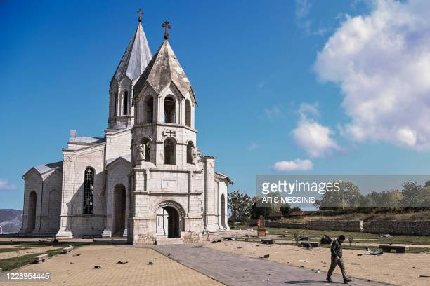 Man walks on October 8, 2020 in the alley leading to the Ghazanchetsots Cathedral in the historic city of Shusha, some 15 kilometers from the...