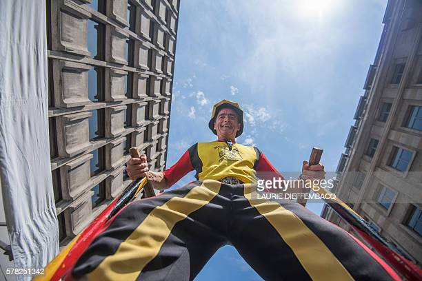 A man walks on stilts during Belgian National Day in Brussels on July 21 2016 / AFP / Belga / LAURIE DIEFFEMBACQ / Belgium OUT