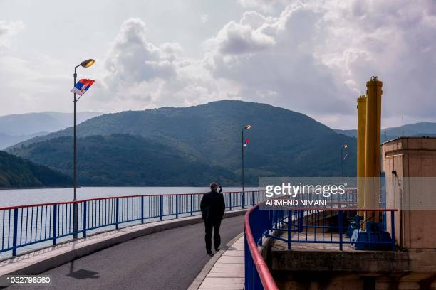 A man walks on the banks of the Gazivode lake in northern Mitrovica on September 8 2018 Controlled by Serbs but a power source for Kosovo the...
