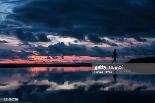 Man walks on the beach during sunset on October 1, 2012 in Utria National Park, Colombia. The Utria National Park lies in the Pacific northern coast...
