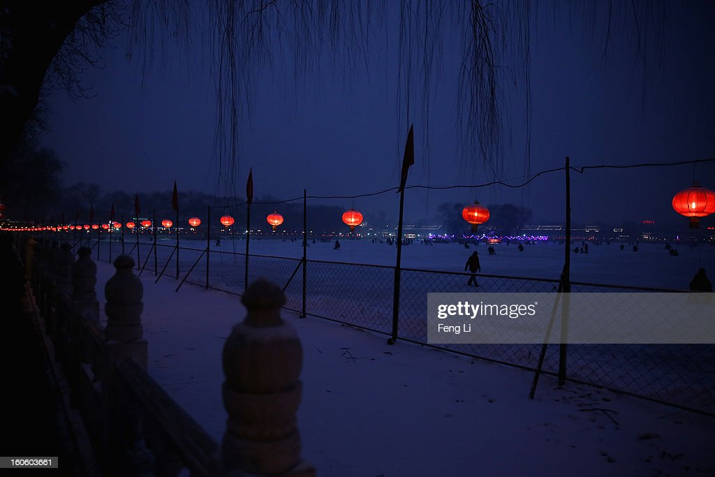 A man walks on the frozen Houhai Lake during severe pollution on February 3, 2013 in Beijing, China. Houhai Lake is a popular place for winter sport and entertainment in Beijing.