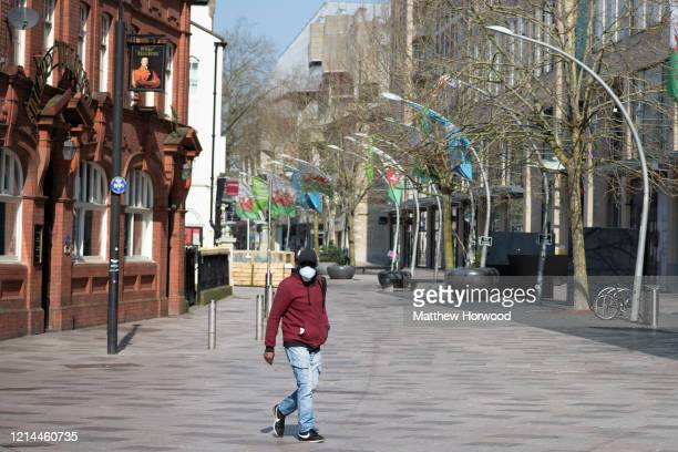 A man walks on the Hayes in Central Cardiff on March 24 2020 in Cardiff United Kingdom British Prime Minister Boris Johnson announced strict lockdown...