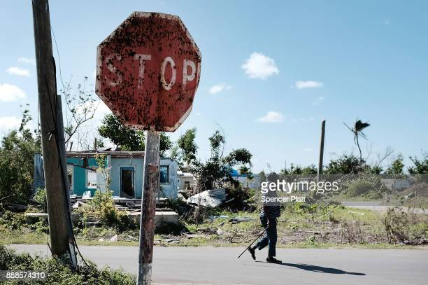 A man walks on the nearly destroyed island of Barbuda on December 8 2017 in Cordington Barbuda Barbuda which covers only 62 square miles was nearly...