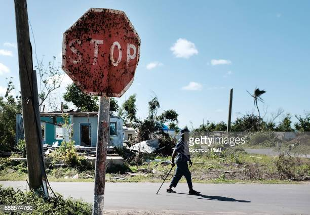 Man walks on the nearly destroyed island of Barbuda on December 8, 2017 in Cordington, Barbuda. Barbuda, which covers only 62 square miles, was...