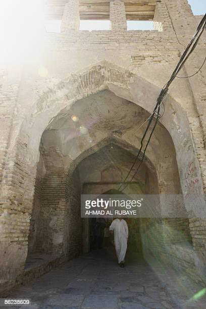 A man walks out of a covered market which leads to the a mosque once the Jewish shrine of Ezekiel the prophet who followed the Judeans into the...