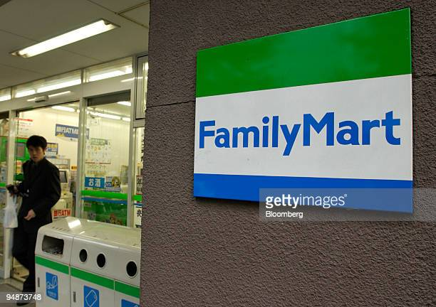 A man walks out of a FamilyMart Co convenience store in Tokyo on October 13 2004 7Eleven Japan Co Lawson Inc and rival convenience store chains said...