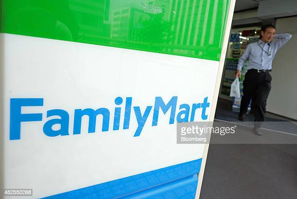 A man walks out of a FamilyMart Co convenience store Tokyo Japan on Wednesday July 23 2014 Japan suspended food imports from Shanghai Husi Food Co a...