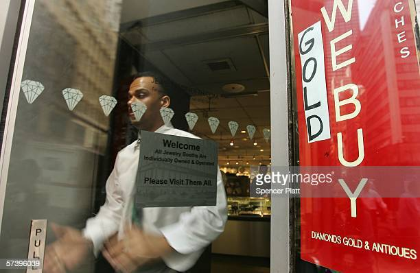 A man walks out of a jewelry store that buys gold April 21 2006 in New York City The price of gold rose to $63260 a troy ounce Wednesday the highest...