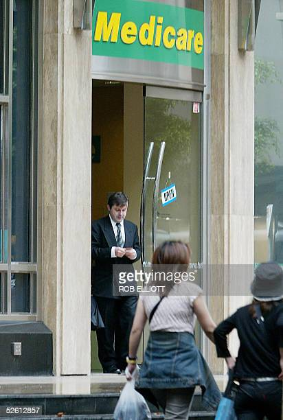 A man walks out of a Medicare office in Sydney 11 April 2005 as the Australian Medical Association threatens to take on the federal government if it...