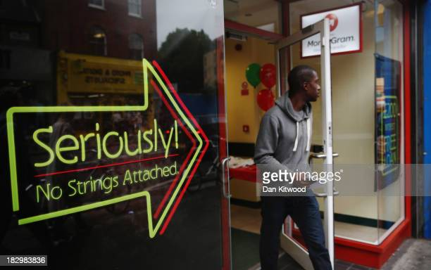 Man walks out of a payday loan store in Dalston on October 3, 2013 in London, England. Payday loan stores are to face tougher regulations after moves...