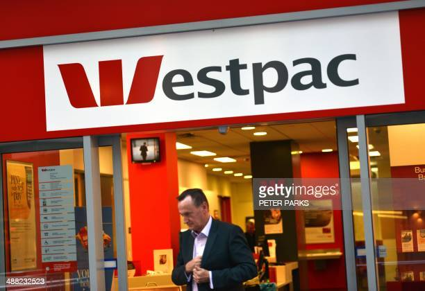 A man walks out of a Westpac Bank in the central business district of Sydney on May 5 2014 Australian banking heavyweight Westpac announced a 10...