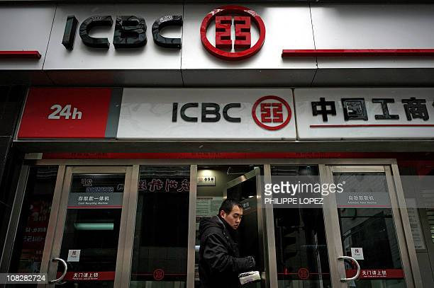 A man walks out of an ATM of a branch of China's banking giant Industrial and Commercial Bank of China in Shanghai on January 18 2011 According...