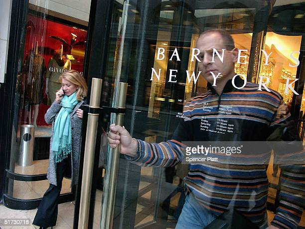 A man walks out of Barneys New York November 11 2004 in New York City The Jones Apparel Group has announced a deal to buy Barneys the clothing chain...