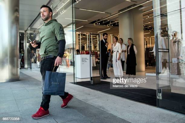 A man walks out of the world's biggest Zara during the opening day The store has 6000 square meters