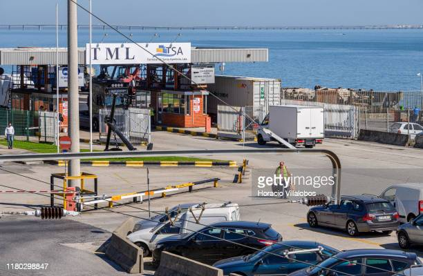 A man walks out of TSA Santa Apolonia multipurpose container terminal on October 10 2019 in Lisbon Portugal Lisbon harbor is one of the largest and...