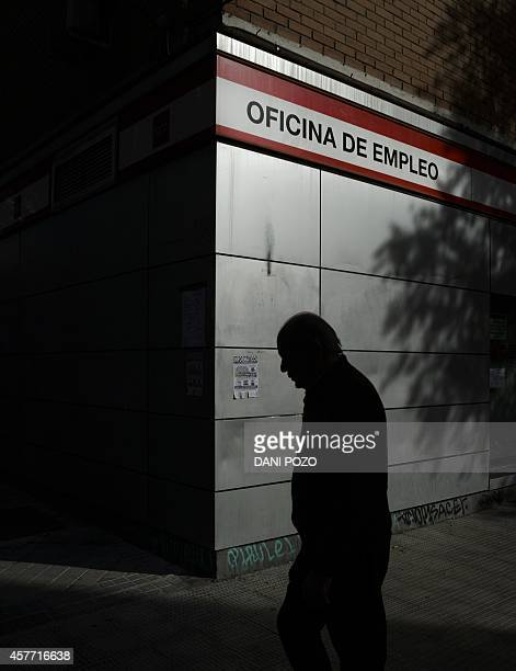 A man walks outside a government job centre in Madrid October 23 2014 The unemployment rate continued its decline in Spain in the third quarter...